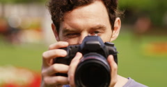 4k, professional male photographer with dslr camera taking a picture of you. Stock Footage