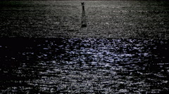 Reflection of moonlight sea with a lighted buoy. Stock Footage
