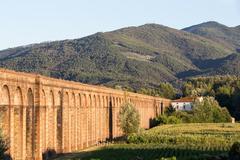 Ancient Italian Aqueduct in Evening Light Stock Photos