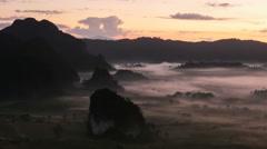 Sunshine on the morning mist at Phu Lang Ka, Phayao, Thailand Stock Footage