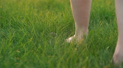 Barefoot Woman Seen By Feet Only Walks On Green Grass Stock Footage