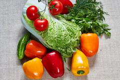 Various ripe vegetables and paprika are filled on a canvas Stock Photos