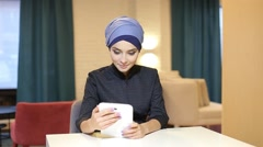 Muslim Girl Student Uses Tablet Stock Footage