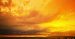 Sunset scene with sun fall behind the clouds in background, time lapse shot Stock Footage