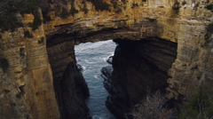 Tilt Down Shot of Cliff Cave in Port Arthur - Tasmania, Australia Stock Footage