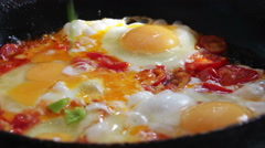 Fried Eggs with Vegetables Prepared on a Frying Pan Stock Footage