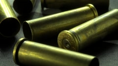 Close Up Slider Shot Of 357 Magnum Shell Casings Laying On A Flag 2 Stock Footage