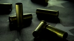 Panning Shot Of 357 Magnum Casings Laying On A Flag.mp4 Stock Footage