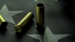 Panning Shot Of 357 Magnum Casings Laying On A Flag 3 Stock Footage