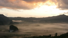 Sunshine on the morning mist at Phu Lang Ka, Phayao, Thailand Stock Footage