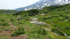 Tourists in valley at mutnovksky volcano kamchatka Stock Footage