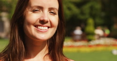 4k, young attractive woman smiling gorgeously at the camera. Slow motion. Stock Footage