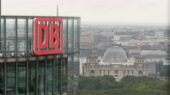 Panoramic shot. DB (Deutsche Bahn) logo on the top of the skyscraper in Berlin, Stock Footage