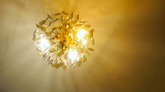 Included crystal chandelier, gold, view from below Stock Footage