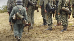 Unidentifiable second world war soldiers marching and taking orders Stock Footage