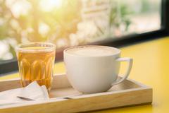 White Coffee Mug on wooden table soft focus background with back lighting Stock Photos