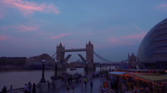 Twilight by the Thames and Tower Bridge in London, UK Stock Footage