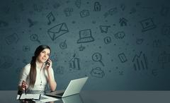 Businesswoman with media icons background Stock Photos