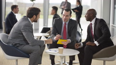 4K Male corporate business team in negotiation in busy modern office Stock Footage