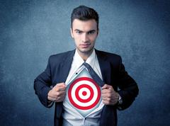 Businessman tearing shirt with target sign on his chest Stock Photos