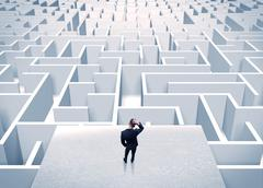 Businessman staring at infinite maze Stock Photos