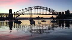 Beautiful pinky sky during sunrise at Sydney Harbour Bridge Stock Footage