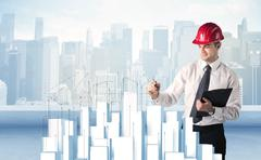 Businessman drawing skyscrapers Stock Photos