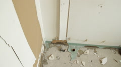Pan around floor of bathroom under renovation Stock Footage