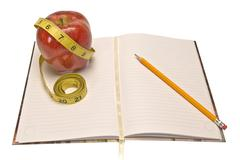 Weight Loss Journal With Tape Measure and Apple Stock Photos