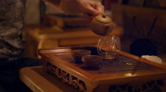 Hands Pouring The Tea Brew Into The Glass Kettle Stock Footage