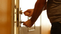 Man unlocking, going in, then out and locking apartment door. Stock Footage