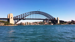 Sydney Harbour Bridge during bright daylight sky Stock Footage