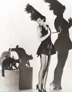 Black cat giving woman in costume the heebie-jeebies Kuvituskuvat