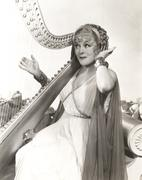 Woman in ancient Greek costume playing harp Kuvituskuvat