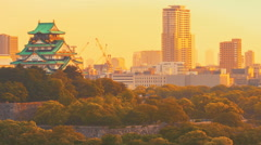 Time-lapse of the historic Osaka Castle at sunset Stock Footage