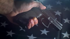 Loading A Hand Gun With The Flag Of The United States In The Background Stock Footage
