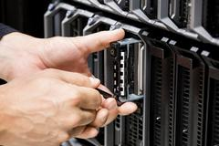 IT Technicians Hands Working On Server At Data Center Kuvituskuvat
