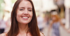 4k, A beautiful young woman on the streets of a city. Stock Footage