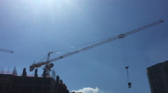 Building Under Construction, Crane against the blue sky Stock Footage