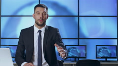 Male News Presenter in Broadcasting Studio. Stock Footage