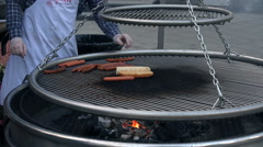 Man Turning The Sausages On The Outdoors Grill Stock Footage