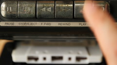 Man's hand inserting the audio cassette into the retro tape player. Stock Footage