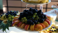 Fresh fruits and vegetables on the white table. Camera dolly Stock Footage