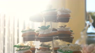 Wedding table with sweets and cakes, pastries sweets, tea table, candy bar Stock Footage
