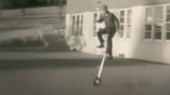 Boys riding unicycle--From 1950's film Stock Footage