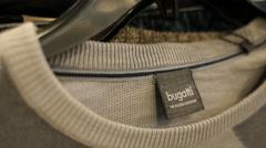 Bugatti label on jumper Stock Footage