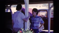 1968: women talking outside in front of truck with hood up COTTONWOOD, ARIZONA Stock Footage