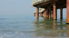 Camaiore lido under pier beach and waves Stock Footage