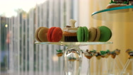 Pan over colorful macaroons in a box Stock Footage