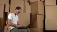 Programmer of a small online shop at work. Man in glasses working on his laptop Stock Footage